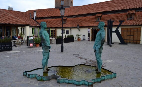 Franz Kafka Statues outside of the Kafka museum in Prague